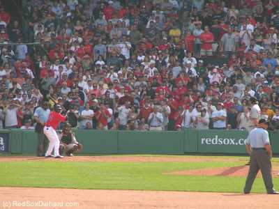 Fans rise as Big Papi steps to the plate in the bottom of the ninth.