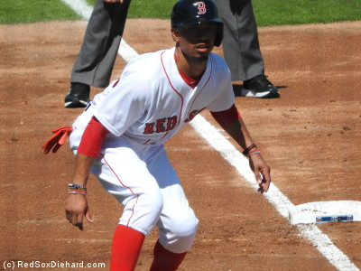 Mookie Betts takes a lead off third base. He scored the first run of the game on Hanley's double.