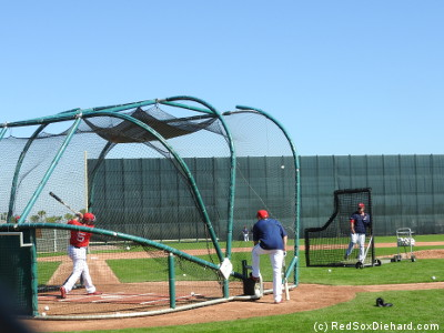 Allen Craig and Josh Rutledge take B.P. under the backdrop of the Green Monster-sized fence on Field 1.