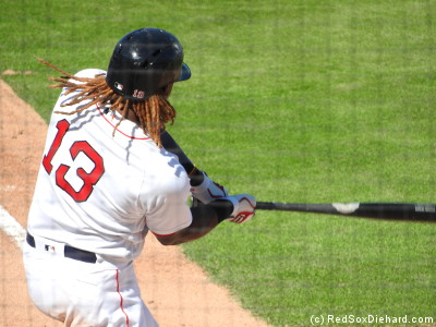 Hanley's hair flaps in the breeze as he swings.