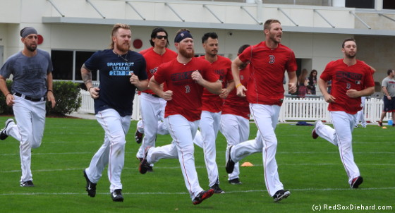 Left to right: Matt Barnes, Robbie Ross, Edgar Olmos, Craig Kimbrel, Joe Kelly, Chris Sale, and Tyler Thornburg were among the pitchers running sprints on the agility field.