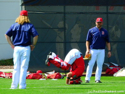 The catchers practiced their floor execrises under the watchful eyes of bullpen catcher Mike Brenley and Jason Varitek.