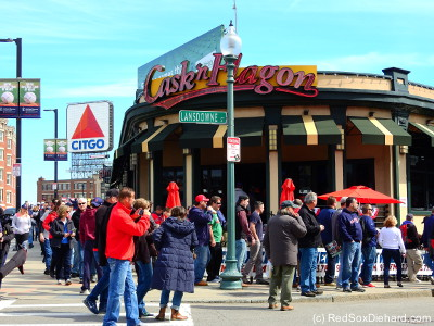 Fans stream past the Cask & Flagon on their way up from Kenmore Square.