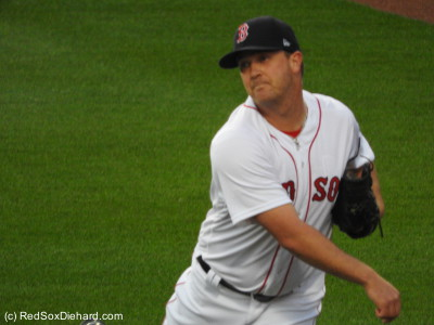 Steven Wright warms up before the game.