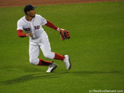 Mookie tracks down a fly ball.