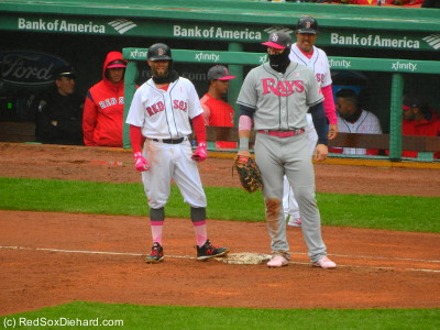 Pedey stands on first base next to Chris Davis.  The whole pink for Mother's Day thing might have been nicer if they weren't so mish-mash with different shades of pink for the socks compared to the batting gloves, and if they had decided to be consistent with wearing either pink or red sleeves under their jerseys.  It looked pretty ridiculous as it was.