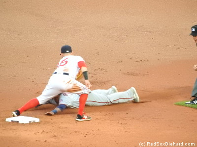 Pedey applies the tag as Sandy Leon cut down yet another baserunner.