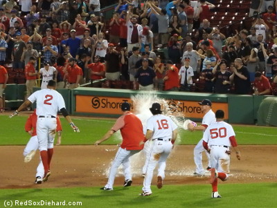 "Pedey didn't get the Gatorade bucket treatment, but Christian Vazquez did get him with a smaller bucket of water as the ""first responders"" chased him across the infield. And look at Xander Bogaerts preparing for takeoff!"