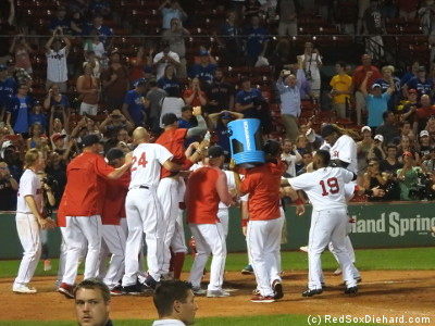 Hanley leaps onto home plate, while his tired teammates wait with the Gatorade bucket.