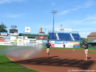 The grounds crew watered the field with rainbows before the game.
