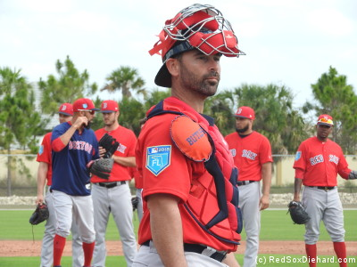 Catcher Dan Butler, who's been in the organization for years and got a cup of coffee in the majors in 2014, waits his turn in a drill. Behind him, David Price, Drew Pomeranz, Williams Jerez, and Roenis Elias line up on the mound.