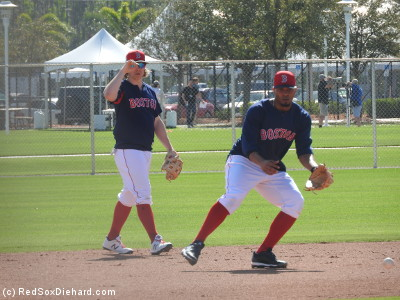 Brock Holt and Xander Boagerts take turns fielding grounders at shortstop.