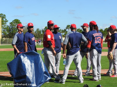 The infielders gathered for fielding practice. Soon they were joined by the pitchers, who also participated in the drill.