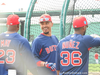 Mookie Betts shares a laugh with Eduardo Nunez and Lee May, Jr., the hitting coach for the Sea Dogs.