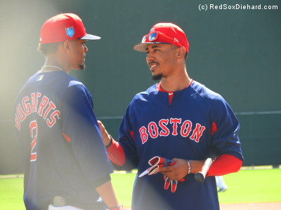Xander Bogaerts and Mookie Betts chat while waiting for batting practice to start.