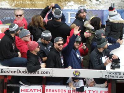 Heath Hembree, Brian Johnson, Ryan Brasier, Brandon Workman, Tyler Thornburg, and Bobby Poyner go by in their duck boat.