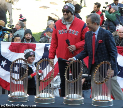 """Nathan Eovaldi got a warm welcome after his impressive performance, pitching multiple innings on back-to-back days as a starter and a reliever, including a record 97 pitches in relief in the 18-inning Game 3. His young son Jace also took to the mic to say, """"Let's go, Red Sox!"""""""