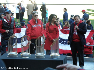 "Red Sox ownership Sam Kennedy, John W. Henry, Linda Pizzuti Henry, and Tom Werner now have four trophies to cart around to events. But Werner set it down facing to the side, and no one on the stage noticed. From the stands, people yelled out, ""Rotate it,"" as our pictures all looked silly. Finally, one of the photographers on the stage sneaked over and fixed it, eliciting a cheer from the crowd."