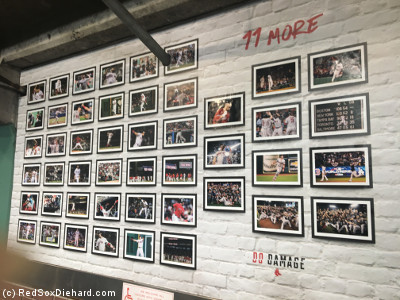 The display in the right field concourse that showed photos representing each of the 108 regular season wins was updated to include 11 more from the postseason.